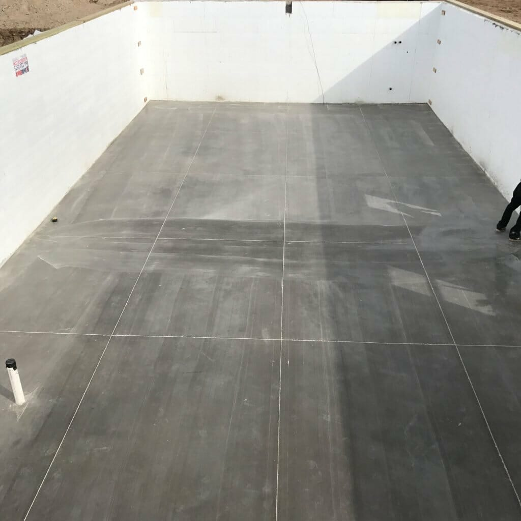concrete basement floor with unfinished walls