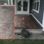 Blue house with custom stamped concrete porch made to look like wood