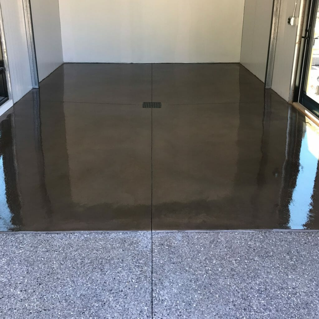 garage floor with drain in the center with polished concrete