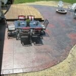 concrete path with fire pit and patio with chairs