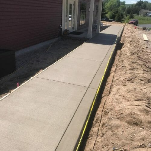 sidewalk along side of house
